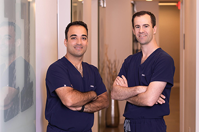 Dr. Joseph Baptist and Dr. Matthew Hamedani, oral surgeons at Cameo Dental Specialists serving the Chicago Communities.
